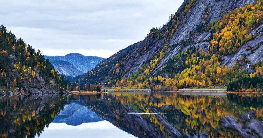 mountain mirroring in calm waters