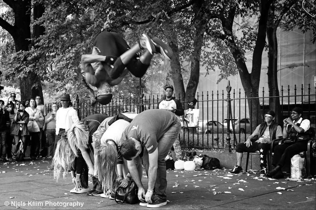 Street performer doing a somersault in New York City